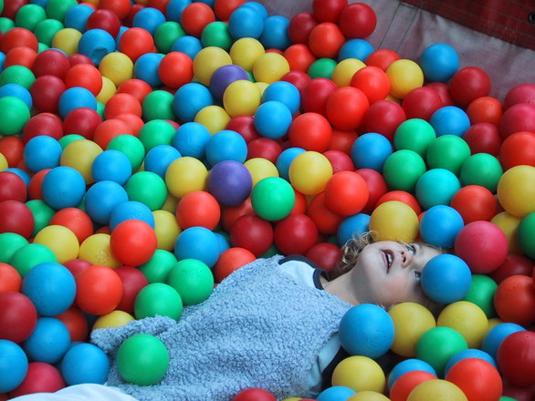 child with color balls