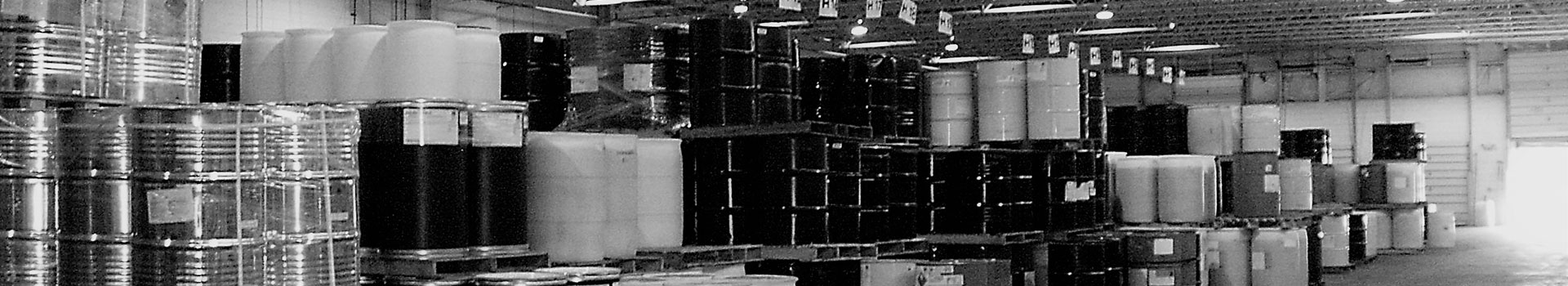 warehouse with stacks of barrels