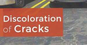discoloration of cracks on asphalt